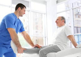 physiotherapist working with elderly patient